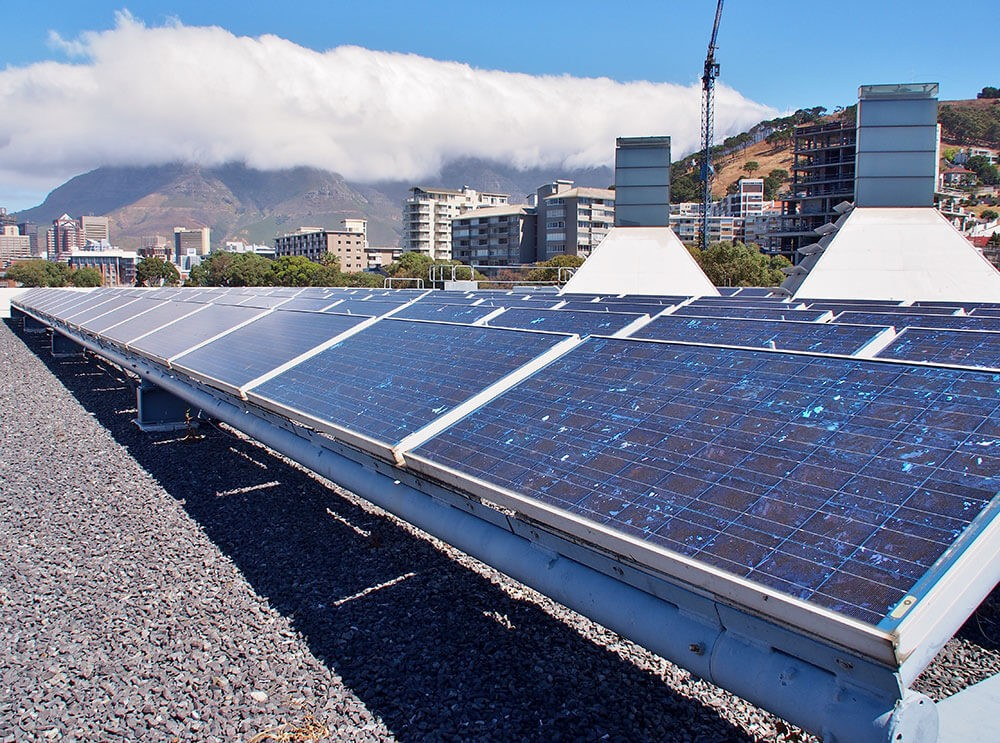 Solar panels or Solar cells on rooftop or terrace of building in Cape Town - IRP 2019: What does it mean for developers